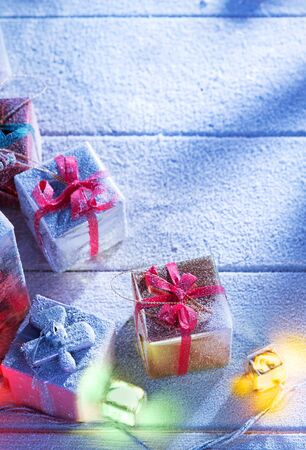snowbound: close up view  of gifts boxes  on snowbound  wooden back Stock Photo