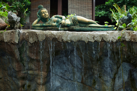 fragment like view of laying girl statue in tropic spa environment Stock Photo