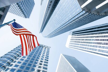 wallstreet: View of American flag on blue building background Stock Photo