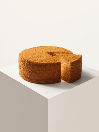 custard slice: close up view of nice fresh yummy honey cake on white back