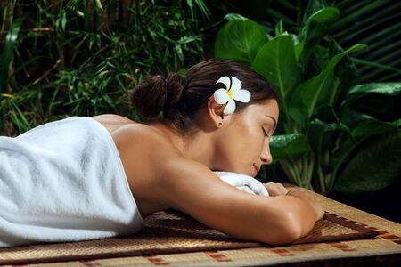 portrait of young beautiful woman relaxing in spa environment Stock Photo