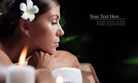 portrait of young beautiful woman in spa environment.  banner