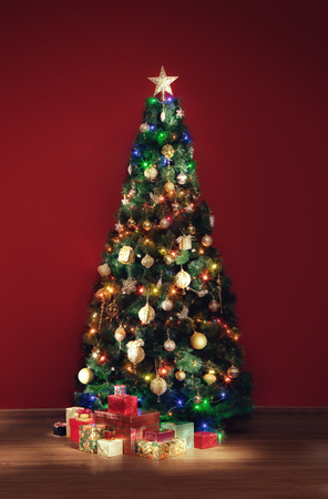 stock photo view of nice decorated christmas tree and some gift boxes indoor - Indoor Decorative Christmas Trees