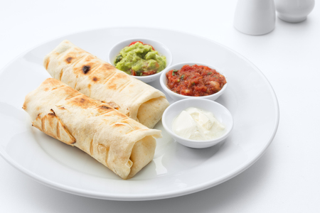 close up view of nice fresh yummy Mexican burritos on white back