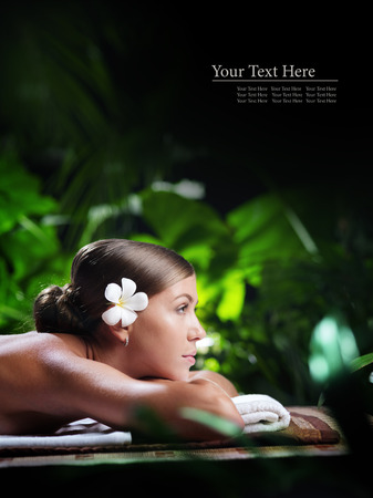 portrait of young beautiful woman in spa environment.  banner. space for text.
