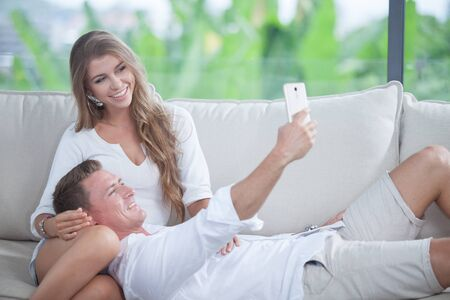 portrait of young couple  making self photo with mobile phone Stock fotó