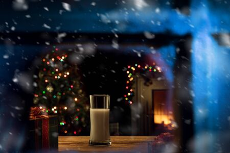 close up view of glass of milk for santa  on color back