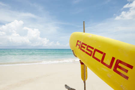 Close up view of rescue surf board on tropic beach background 写真素材