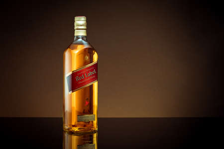 Phuket, Thailand- Feb 2021. Johnnie Walker Red Label blended whisky isolated in the dark Publikacyjne