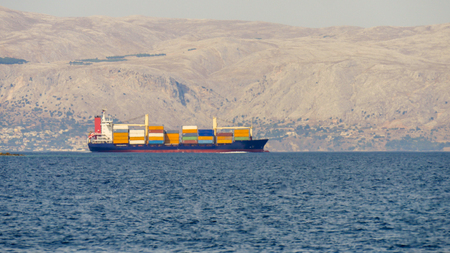 Blue cargo container ship transporting import or export goods.