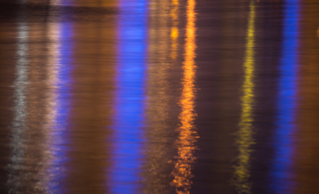 Lights reflecting in rippled sea water surface Stock Photo