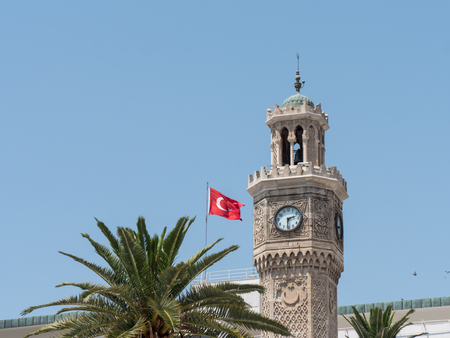 izmir clock tower, Turkish flag and palm tree in izmir city Turkey