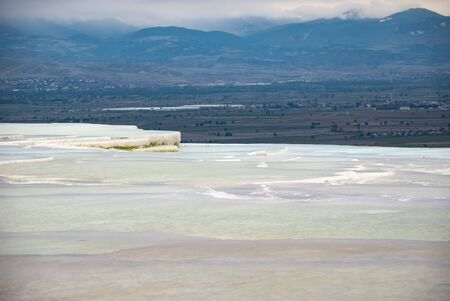 The landscape of Pamukkale, Denizli, Turkey, a natural site famous for a carbonate mineral left by the flowing water.
