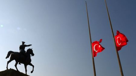 Mustafa Kemal Ataturk riding horse sculpture silhouette and Turkish flag, lower the flag to half-staff in 10 november