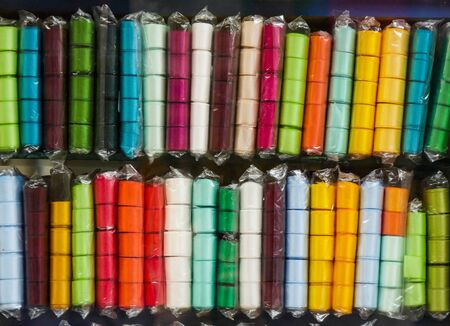 colored textile ribbons for sale on needlework store shelves. Textile industry.