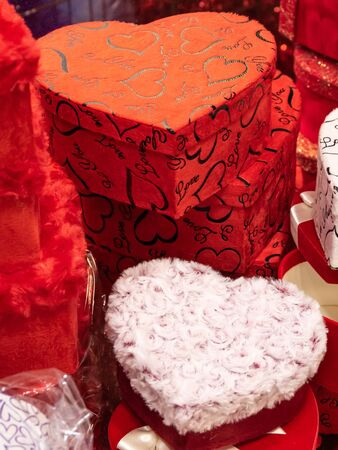 Close-up of red heart-shaped gift boxes. Happiness, valentines day love and celebrating concept. Banco de Imagens
