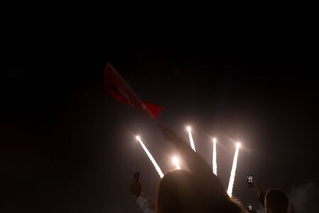 Colorful fireworks on the black sky background. Celebration.