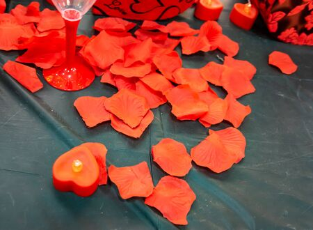 Close up imitation or artificial red roses leaves background.