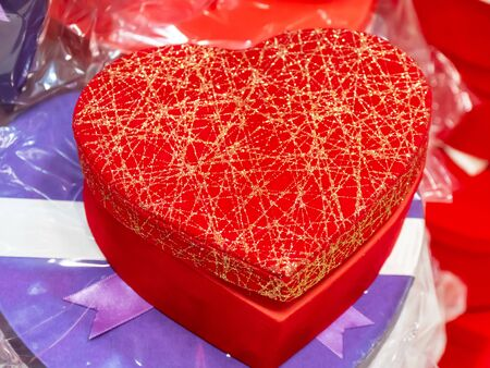 Close-up of red heart-shaped gift boxes. Happiness, valentines day love and celebrating concept. Stok Fotoğraf