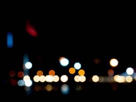 Defocused bokeh color lights abstract background. Colorful dots defocused background. Imagens