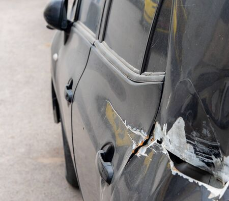Rear left side of car get damaged by accident. Car insurance concept. Imagens