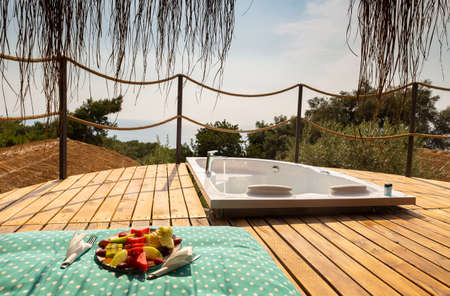 Hot tub in the hotel room suite balcony with sea view. Summer day honeymoon romantic Luxury resort vacation place