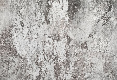 Grunge white dirty cracked concrete wall Reklamní fotografie