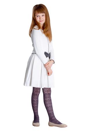 skirts: Niña bonita con un vestido blanco de pie en el fondo blanco Foto de archivo