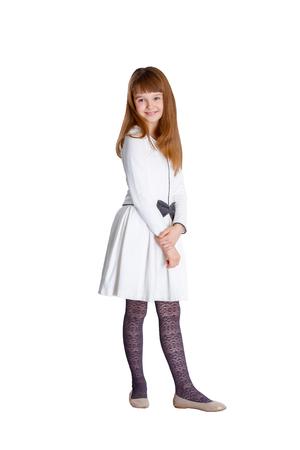 little models: Pretty little girl wearing white dress standing on white background