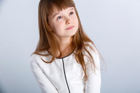 Smiling little girl in the white dress photo