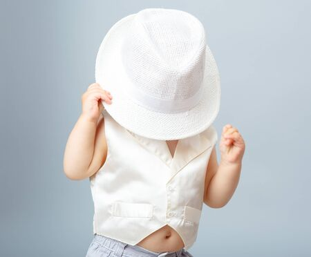 The child in a white hat, babe boy