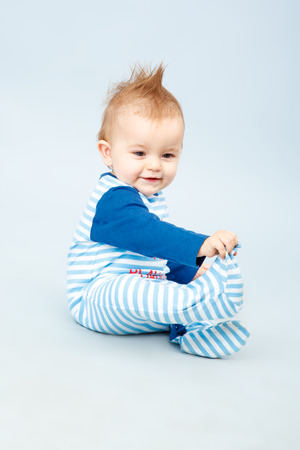 beautiful little baby in the blue striped shirt