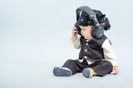the beautiful baby with headphone, boy photo