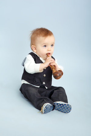 lamentable: the Little boy with the pipeful, child Stock Photo