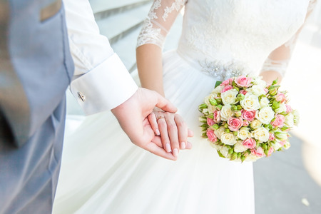 Wedding couple holding hands. bride and groom