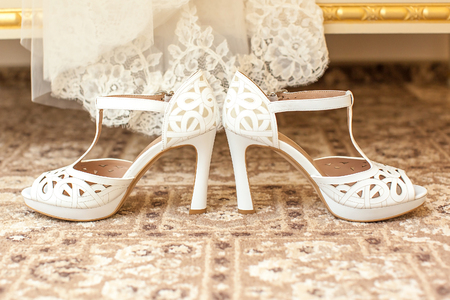 white beautiful wedding shoes of the bride. photo