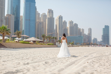lifestyle: Bride At Beautiful Beach Wedding sunny day Stock Photo