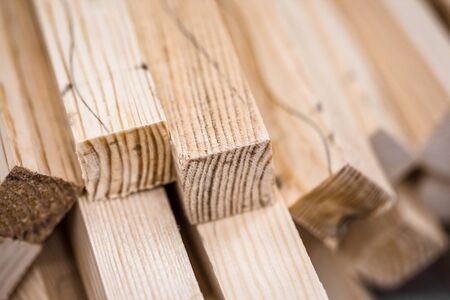 wooden beams: Wooden beams and planks. Lumber stacked at construction site