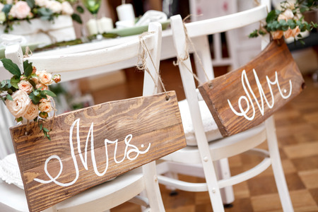 wedding table decor: Mr. & Mrs. Sign on the chair Stock Photo