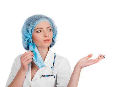 protective equipment: Preparing to surgery, protective equipment concept.beautiful woman doctor wearing surgical mask specifies a hand isolated on white background Stock Photo