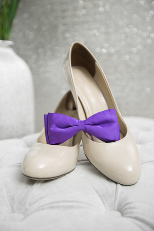 purple shoes: purple bow tie and beautiful wedding shoes of the bride. Stock Photo
