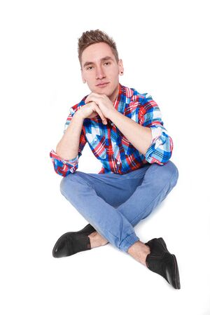 checked shirt: attractive young cheerful man in checked shirt on white background