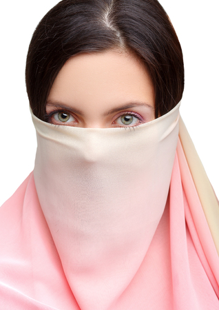 handkerchief: young womans face covered with a pink  handkerchief.