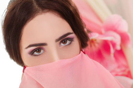 face covered: young womans face covered with a pink  handkerchief.