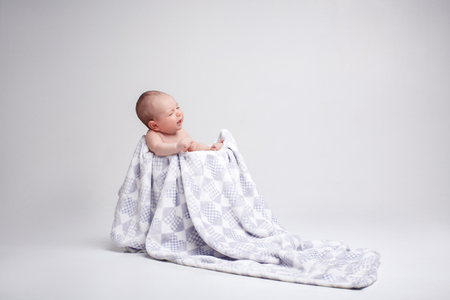 cries: cute kid lying on his back. the baby is cries Stock Photo