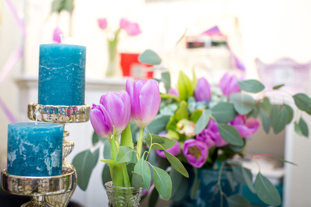 blue candles: the blue candles and purple tulips