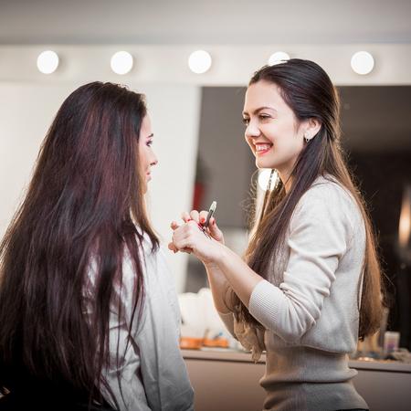 artist model: Makeup artist apply makeup to a model.