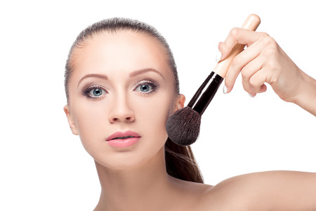 makeover: Beauty woman with Makeup Brushe. Natural Make-up for Brunette girl with blue Eyes. Beautiful Face. Makeover. Perfect Skin. Applying Makeup