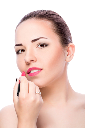 applying lipstick: Professional Make-up. Makeup. Pink  lipstick . woman applying lipstick on lips