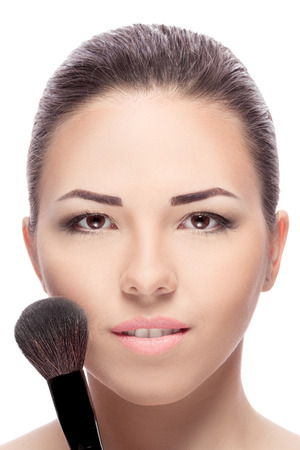 applying makeup: Beauty woman with Makeup Brushes. Natural Make-up for Brunette girl with Brown Eyes. Beautiful Face. Makeover. Perfect Skin. Applying Makeup Stock Photo
